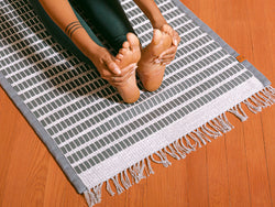 woman practicing yoga on handwoven, organic hemp, non-toxic foam stone Ritual Rug yoga mat