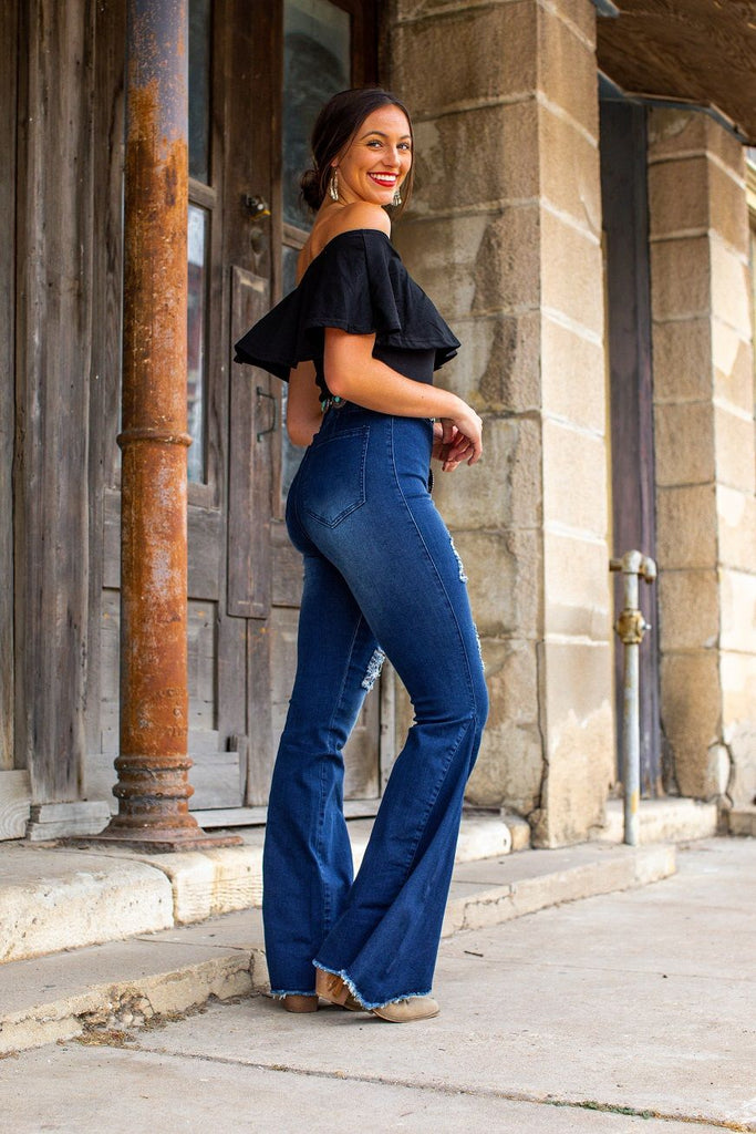 Mid Wash High Rise Distressed Denim Flares