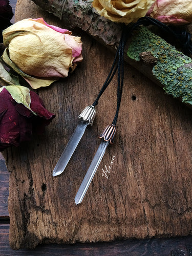 Clear crystal point with metal flower
