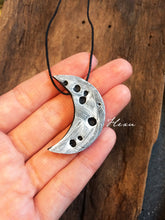 White moon clay pendant