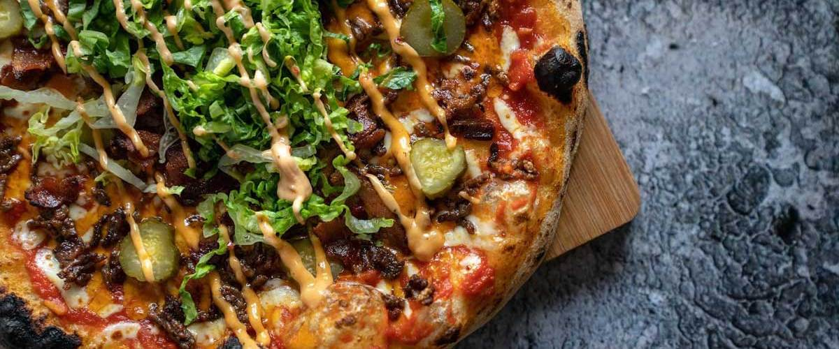 Bacon Double Cheeseburger Pizza   Our 12 Favourite Ooni Recipes   Outdoor Concepts NZ