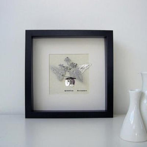 Epmedium Barrenwort botanical illustration in stainless steel. Three dimensional floral drawing mounted on parchment paper and framed in a black box frame.