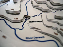 Metal map showing contoured hills above Hathersage and River Derwent