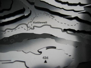Kettle well on the Dales Way detail on stainless steel contoured map