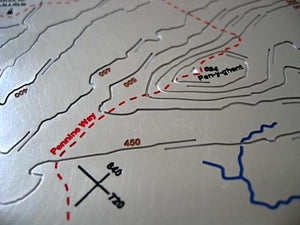 Pennine Way crosses Pen-y-ghent on 3D metal relief map. Also shows Plover Hill