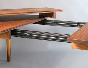 Simply Beautiful Extension Table shown in Walnut with a close up of the open extension displaying our generational quality