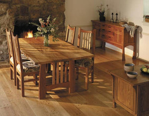 Highland Table shown with Highland Chairs and Huntboard in Natural Cherry w/ Contrasting Accents is a family-sized dining set