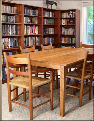 Basic Bookcase in Cherry with Mahogany Wash by Hardwood Artisans is shown with added bookcases, table & chairs for library