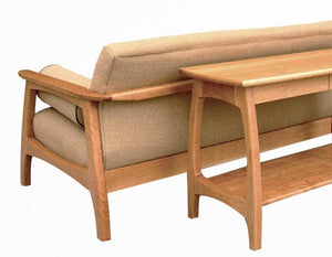 Linnaea Sofa Table shown behind Linnaea Sofa in Cherry made-to-order hardwood furniture using sustainable sourced hardwoods
