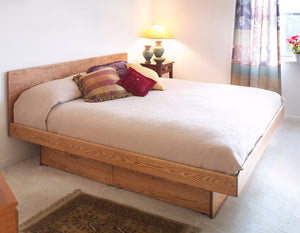 Platform Pedestal bed with Basic Headboard in Red Oak as bedroom furniture made at Hardwood Artisans near Hamilton Virginia
