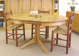 Walden Small Round Extension Table in Red Oak feature matching middle table extensions called leaves placed in the center gap