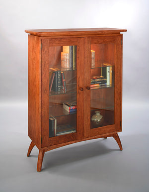 Linnaea Library is quality furniture cabinet made with real, solid hardwood, ornamental legs and 3 adjustable glass shelves