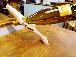 The Magic Salmon Wine Bottle Holder in assorted woods displaying a fish design works as art or a fun gift and Made In America