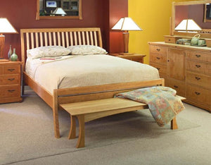 Artisan Sleigh Bed with Curved Legs in Natural Cherry with Curly Maple Slats shows custom bedroom furniture in Gainesville VA