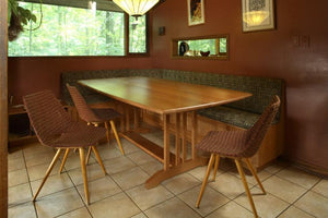 Arts & Crafts Banquette Table features a trestle base, seats up to 8 people, chic dining room style family-sized furniture