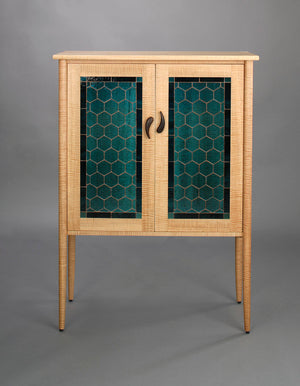 Library shown in Curly Maple with Art Glass, a Custom Sustainable Cabinet Design by Hardwood Artisans near Rappahannock VA