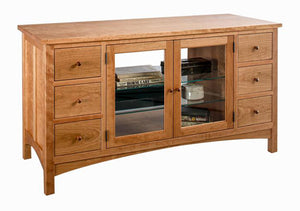 Craftsman TV Console in Natural Cherry features 6 drawers & 2 glass adjustable shelves behind frame and glass panel doors