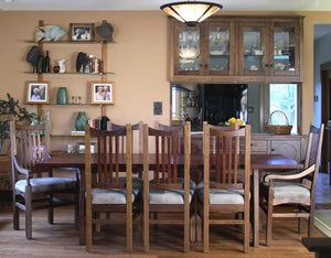 Highland Chair pictured with Arm and Side Chairs, Highland Dining Table and Custom Dining Cabinets in Walnut near Clifton