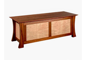 Waterfall Bench in Mahogany with Curly Maple Panels is a custom bedroom furniture chest used for storage by Hardwood Artisans