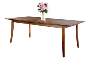 Simply Beautiful Table shown in Walnut is an extension table with elegance handmade using Amish joinery for strength & beauty
