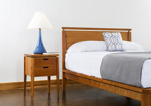 Susan Nightstand shown with matching bed set is a space saving bedroom furniture design by Hardwood Artisans near Burke VA