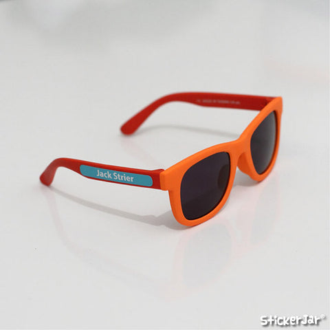 Skinny stick on name labels on a pair of childrens sunglasses