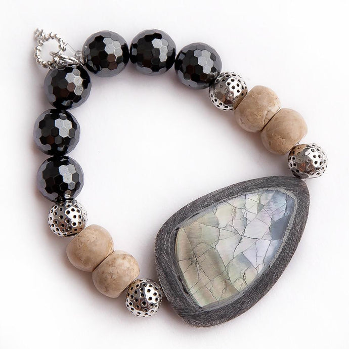 Faceted gunmetal hematite paired with Abalone and driftwood statement slice