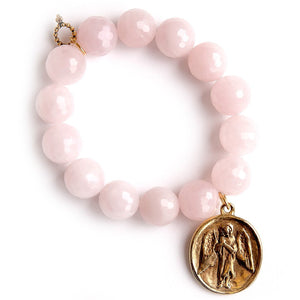 Faceted iridescent rose quartz paired with an exclusively cast bronze guardian angel medal