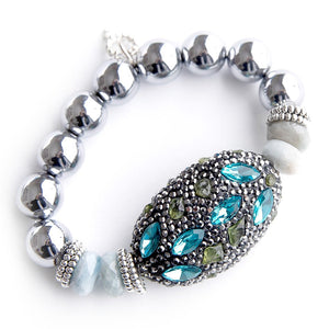Bali mosaic with aquamarine rhondelle accents on 12mm silver hematite