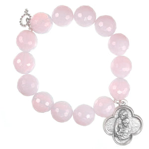 Faceted pink opalite paired with a scalloped Holy Family medal