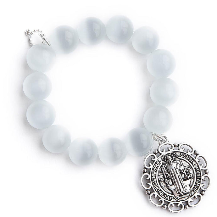 White calcite paired with an ornate Saint Benedict medal