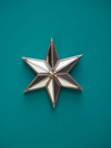 Pointed gold star mirror