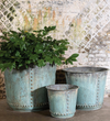 Set of three hammered metal planters