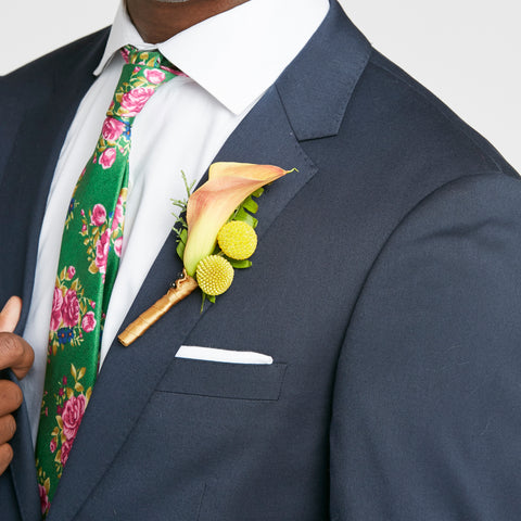 navy suit for formal high school dance with floral tie and yellow and orange boutonniere ideas