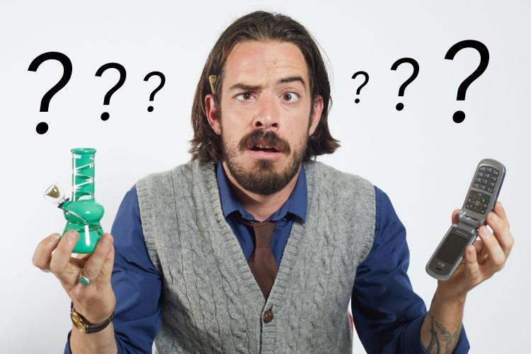 A guy holding a small green water pipe and a cellphone, questioning look on his face and question marks on the sides