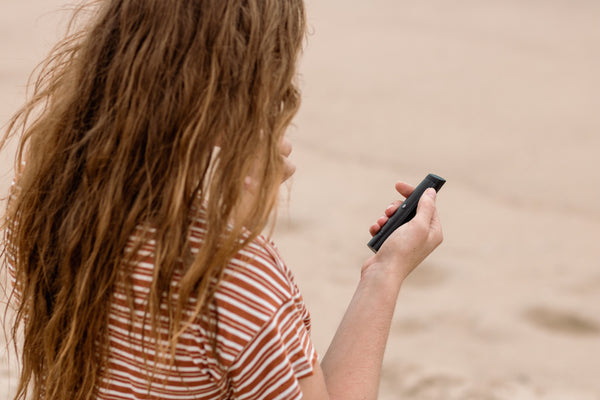Girl at the beach with G Pen Pro Dry Herb Vape