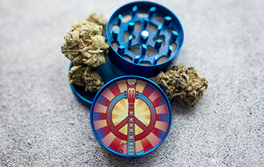 Blue herb grinder with peace symbol
