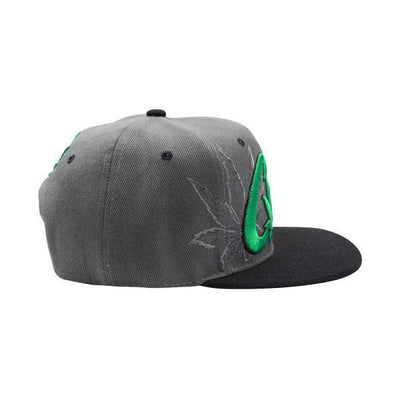 Side shot of cool gray snapback cap black visor with green Cali word and weed leaf design facing right