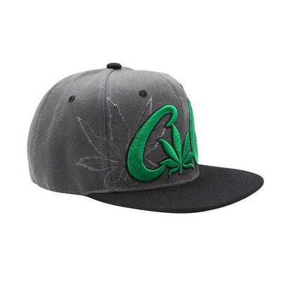 Side shot of cool gray snapback cap black visor with green Cali word and weed leaf design facing right slightly frontal