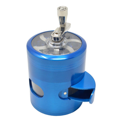 Top shot blue 56mm dub grinder mechanical sharpener look hand crank on back kief catcher opening facing front