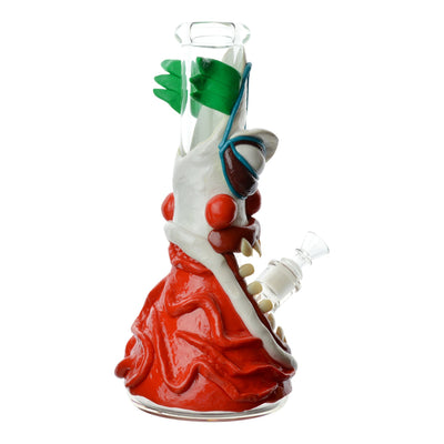 Sideview 12 inch bong shape and look of scary angry Giggles the Clown many teeth facing right bowl on right slightly back