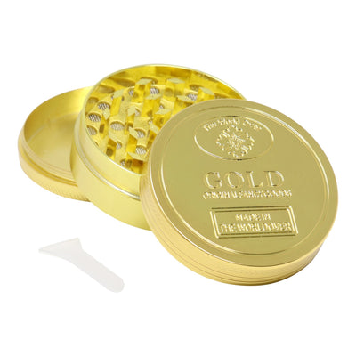 Elegant 40mm in diameter slick metal herb grinder with 3 parts in smooth glossy exterior word gold embossed on lid