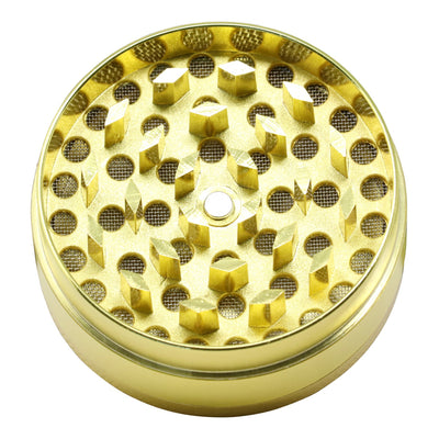 High view of 40mm slick metal herb grinder with smooth glossy exterior sharp teeth