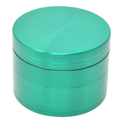 Full high angle shot of green colored 46mm metal grinder smoking accessory closed grinder container