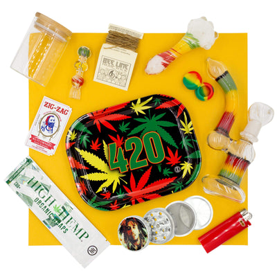 Set of rasta bong, herb bowl, 4-inch pipe, chillum, 420 tray, grinder, jar, container, wraps, zigzag pack and Bic lighter
