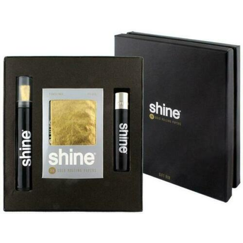 Elegant opened Shine black gift box on left with a cone gold rolling papers and lighter closed Shine black gift box on right