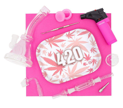 Cute set of pink dab rig, herb bowl, banger, torch, dab tool, 420 container, tray and nectar collector