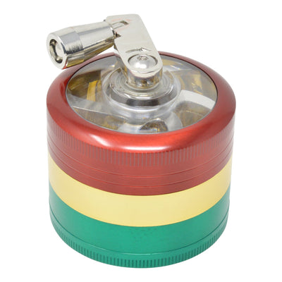 High angle close up shot of closed rasta dub grinder in red, yellow and green colors with hand crank on left
