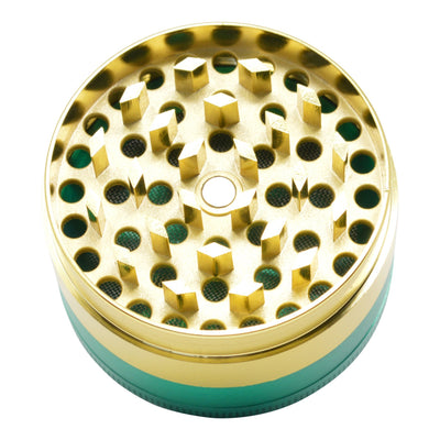 Full shot of the yellow scraper of 4-piece rasta themed opened 48mm grinder with green chamber