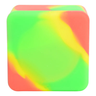 Full close up shot of closed square rasta-themed wax container in red, yellow and green color swirls